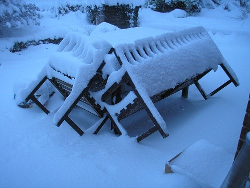 This was honestly the only photo I could find of the old table, bench and chair that used to be outside the back door. It was taken Dec. 2010 when we had a really bad winter.