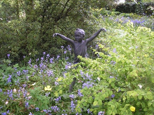 Sculpture with bluebells.