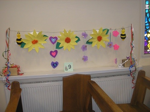 The girls from the Children's Liturgy group made paper flowers.