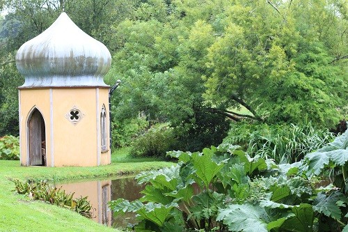 In the far corner of the garden we found a Shell House folly reflected in the stream.