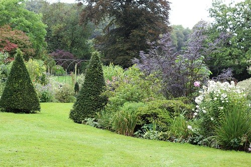 The planting near the house is more formal, becoming wilder nearer the boundaries.