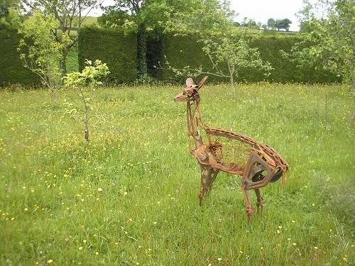 Rusty deer sculpture.